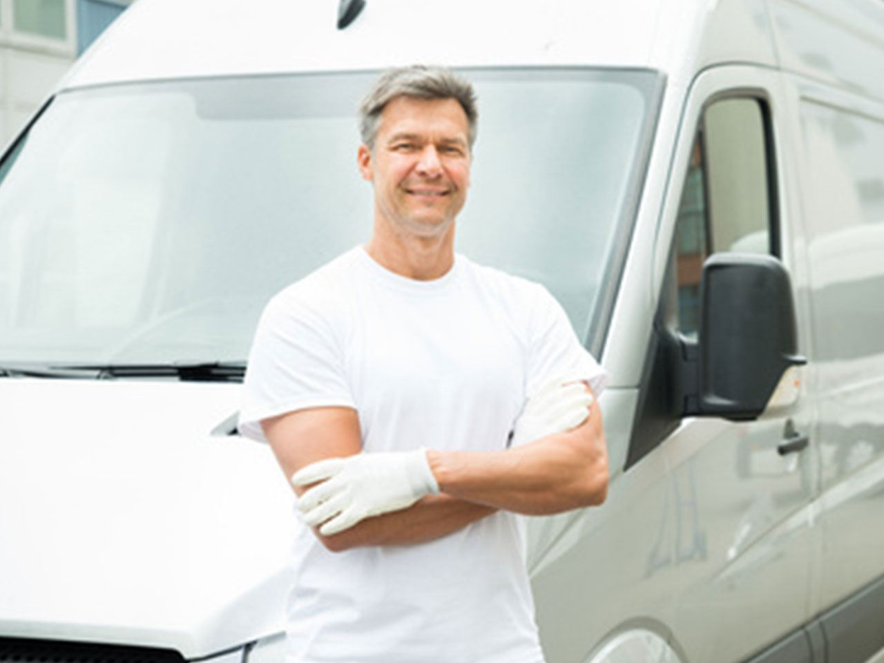 2. Painter-With-Arms-Crossed-In-Front-Of-Van